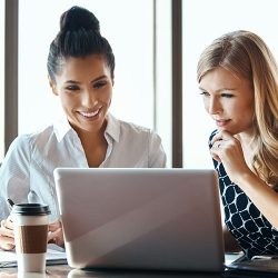 Cropped shot of two attractive young businesswomen working in a modern office